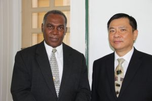 (l-r) Premier of Nevis Hon Vance Amory and Resident Ambassador of the Republic of China (Taiwan) to St. Kitts and Nevis His Excellency George Gow Wei Chiou during a courtesy call on July 14, 2015, at the Nevis Island Administration building at Bath Plain