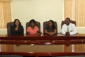 (L-R) Permanent Secretary in the Ministry of Health Nicole Slack-Liburd, 2015 Medical University of the Americas /Nevis Island Administration Health Science Scholarship awardees Clayticia Daniel and Pearl Bergan and Assistant Secretary in the Premiers Ministry Kevin Barrett at a press briefing at the Ministry of Finance conference room on July 6, 2015