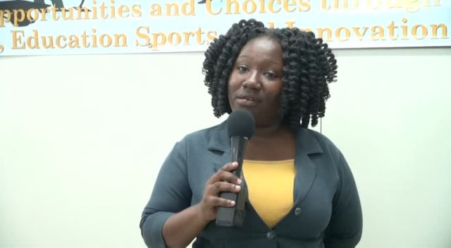 Youth Officer Lanisa Burke during the prize giving ceremony at the Department of Youths and Sports conference room in Charlestown on July 28, 2015