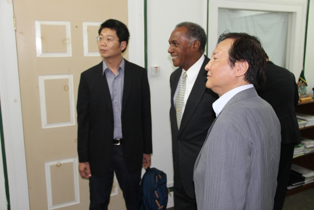 (l-r) Taiwan International Cooperation and Development Fund Specialist Yu-Ming Lu, Premier of Nevis Hon. Vance Amory and during a courtesy visit on July 14, 2015 at the Nevis Island Administration's Bath Plain office.