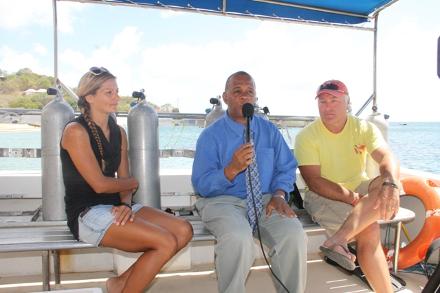 Scuba Safari's Valerie Gregoire (left) and Reef Check Specialist James Hewlett (right) being interviewed by Permanent Secretary in the Ministry of Agriculture and Fisheries Eric Evelyn on June 25, 2015 for an upcoming NTV8 Eye on Agriculture programme