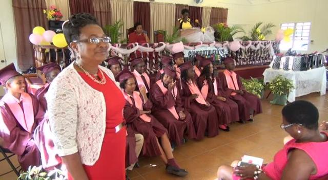 Veteran Educator on Nevis Marion Lescott with the graduating class of 2015 at their recent graduation ceremony of the Elizabeth Pemberton Primary School at the United Pentecostal Church, Marion Heights