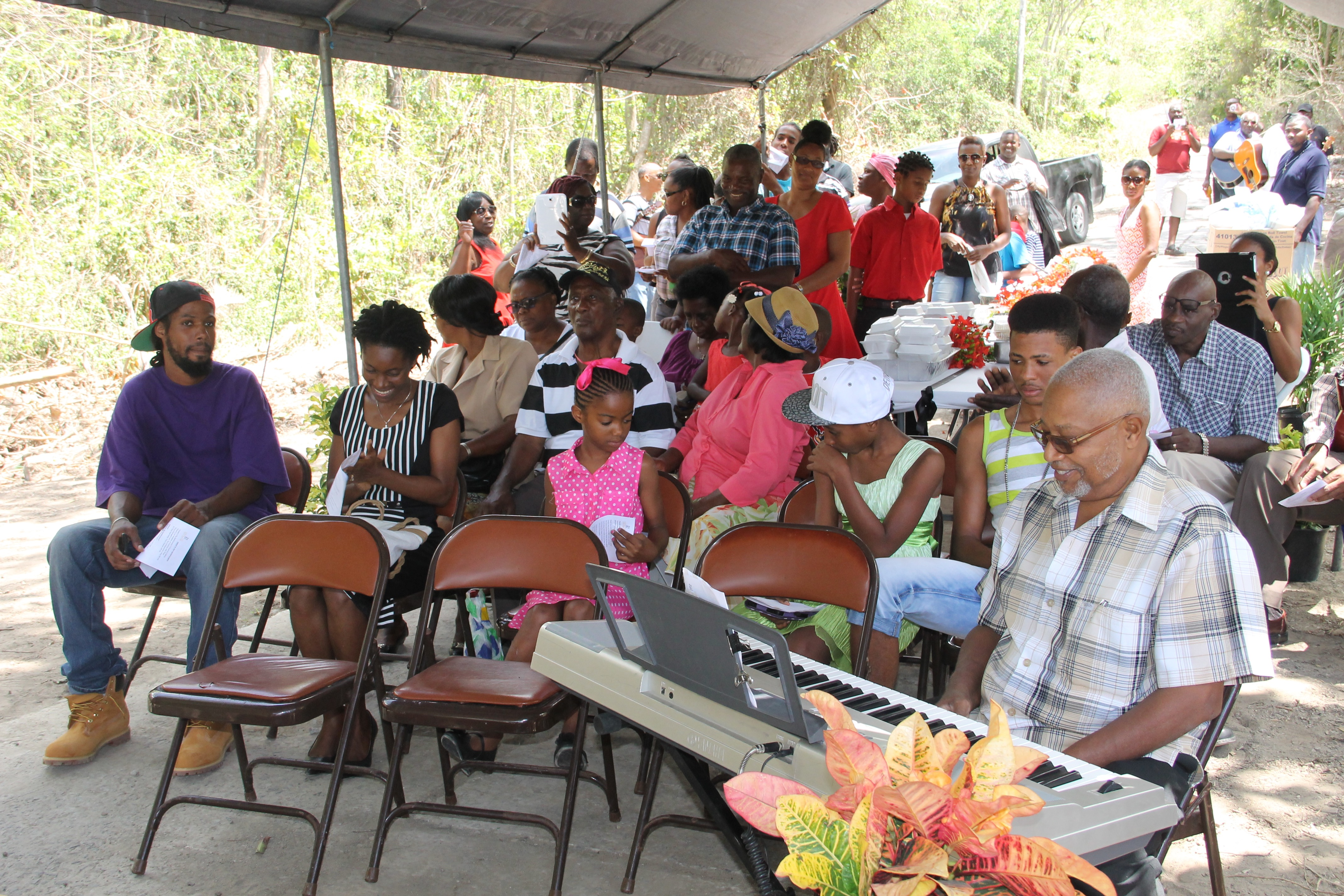 "Friends and family members of Albertine ""Dovie"" Elliott at her birthday celebration on July 10, 2015, at Valley, New River"
