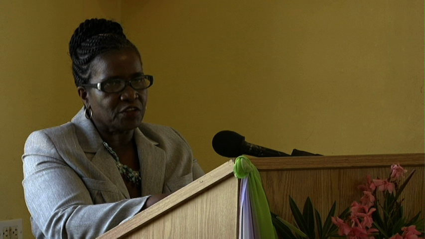 Course coordinator Adina Taylor delivering remarks at the Department of Education's Prospective Teachers' Course closing ceremony on July 03, 2015 at the Department of Education's Conference Room at Pinney's Industrial Site