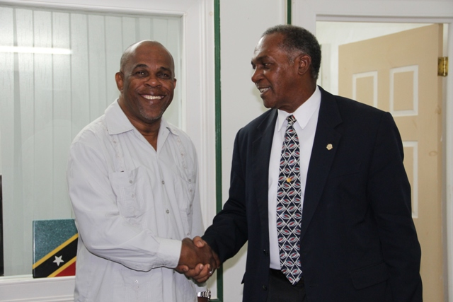 Premier of Nevis (r) welcomes Leader of Government St. Eustatius Mr. Clyde Van Putten to his Bath Hotel office during a courtesy call on July 22, 2015