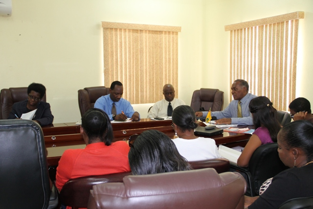 Premier of Nevis and Minister of Education Hon. Vance Amory (at the head of the table) addressing head teachers on Nevis at a meeting at the Ministry of Finance conference room on July 21, 2015. He is flanked by Permanent Secretary in the Premier's Ministry Wakely Daniel (left), Assistant Secretary Kevin Barett (second from left) and Principal Education Officer Palsy Wilkin (to his right)
