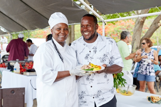 Chef Fredericks shows of her mango inspired dish with her husband at The Nevisian Mango Feast hosted by the Nevis Tourism Authority at Oualie Beach on July 12, 2015. Photo by Refined Digital Media