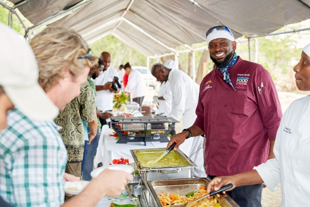 Chef Gregory and Chef D'Lashley serving patrons their mango inspired dishes at The Nevisian Mango Feast hosted by the Nevis Tourism Authority at Oualie Beach on July 12, 2015. Photo by Refined Digital Media