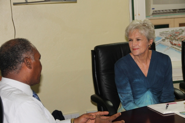Premier of Nevis and Minister of Education Hon. Vance Amory and California based two-time Olympian Marilyn King at the Nevis Island Administration (NIA) conference room at Bath Hotel on August 25, 2015