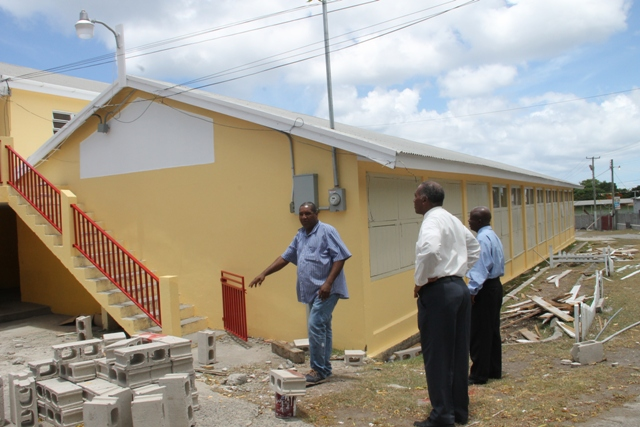 Premier of Nevis and Minister of Education Hon. Vance Amory (center) accompanied by Permanent Secretary in the Premier's Ministry Wakely Daniel (right) touring the Charlestown Secondary School on August 11, 2015 with contractor Jonathan Liburd (left) for a first-hand look of progress on the Schools Rehabilitation Project there