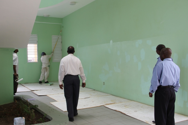 (L-R) Premier of Nevis and Minister of Education Hon. Vance Amory accompanied by Permanent Secretary in the Premier's Ministry Wakely Daniel touring the Charlestown Secondary School Sixth Form College on August 11, 2015 with contractor Jonathan Liburd for a first-hand look of progress on the Schools Rehabilitation Project there