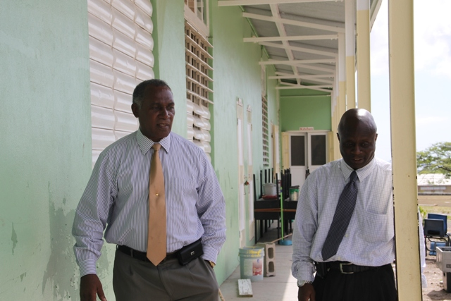 Premier of Nevis and Minister of Education Hon. Vance Amory and Permanent Secretary in the Premier's Ministry Wakely Daniel visiting the Ivor Walters Primary School at Brown Hill on August 18, 2015, for a first-hand look at ongoing works under the Schools Rehabilitation Project funded by the Nevis Island Administration