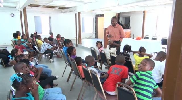 Officer in Charge of the Nevis Disaster Management Department Brian Dyer speaks to participants of the 26th annual Environmental Education Programme, offered by the Nevis Public Library Services at the Methodist Church Hall on August 05, 2015