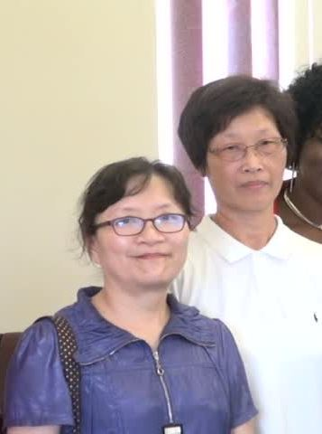 (l-r) Crop Pest and Disease Control specialist Tau-Mei Chou and Soil Fertilisation and Management Specialist Lin Yu Wen, facilitators for the Pest and Disease Control and Soil Fertilisation Enrichment workshop during a visit to Minister of Agriculture Hon. Alexis Jeffers at his office on August 17, 2015