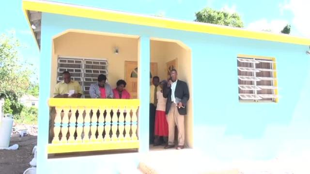 A new three-bedroom concrete house worth more than EC$75,000 handed over to 84-year-old Estelle Bartlette at Old Hospital Road on August 17, 2015