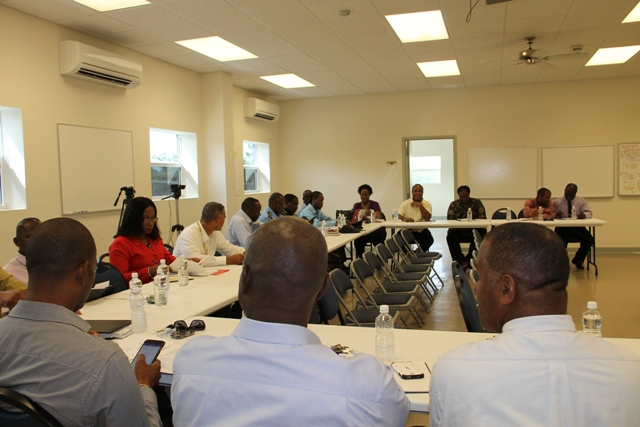Some members of the Nevis Disaster Management Committee at a planning meeting on at the Llewellyn Newton Disaster Management Facility on July 30, 2015