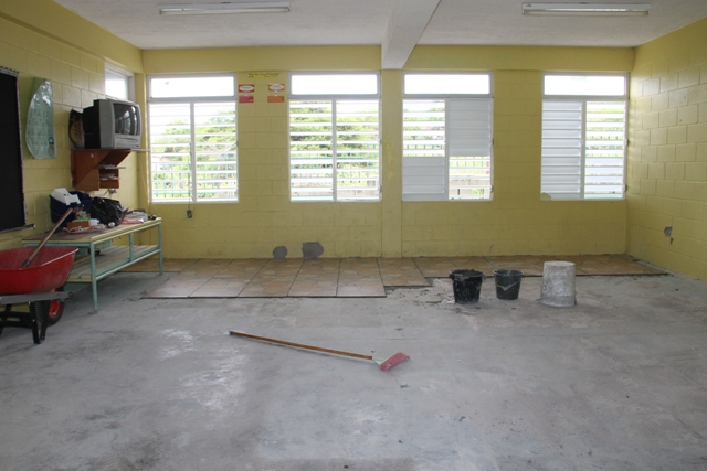 Ongoing tile work at a classroom at the Charlestown Primary School on August 11, 2015 as part of the Nevis Island Administration's Schools Rehabilitation Project there