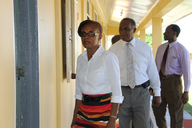 (L-R) Deputy Principal of the Gingerland Secondary School Lineth Williams guides Premier of Nevis and Minister of Education Hon. Vance Amory, Assistant Secretary in the Premier's Ministry Kevin Barrett and Permanent Secretary in the Premier's Ministry Wakely Daniel on a tour of the school on September 07, 2015