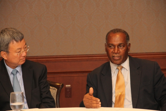 Deputy Managing Director of the International Monetary Fund Min Zhu and Premier of Nevis and Minister of Finance Hon Vance Amory at a meeting with stakeholders at the Four Seasons Resort on September 02, 2015