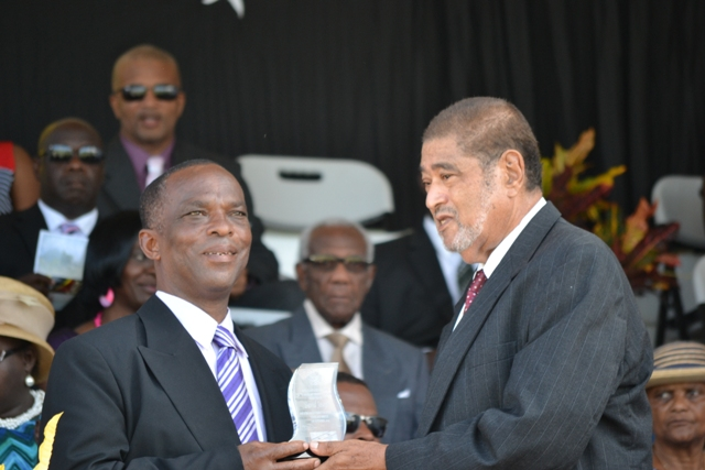 David Joseph receiving his award for his sterling contribution in the area of Community Service from Deputy Governor General His Honour Eustace John at the 32nd Anniversary Independence Ceremonial Parade and Awards Ceremony at the Elquemedo T. Willet Park on September 19, 2015