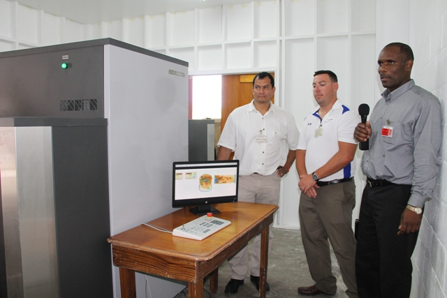 Permanent Secretary in the Ministry of Finance Colin Dore (extreme right) with ADANI officials - Vice President, Operations Scott Ortilani (center) and Sales and Service Manager Salvador Leanos