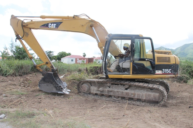 Land clearing with the assistance of equipment from the Nevis Housing and Lands Development Corporation to enhance the security of students and staff at the Medical University of the Americas at Pot Works on September 28, 2015