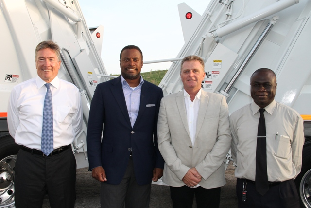 (L-R) Omni Global representative David Johnson, Deputy Premier of Nevis and Minister of Health Hon. Mark Brantley, Caribbean Region Operation Manager for US-based Omni Global Steve Hammond and General Manager of the Nevis Solid Waste Management Authority Andrew Hendrickson, at the handing over ceremony of two state-of-the-art Kenworth garbage collection trucks at the Long Point landfill on September 17, 2015
