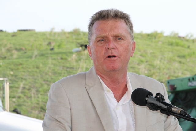 Steve Hammond, Caribbean Region Operation Manager for US-based Omni Global, at the ceremony handing over two state-of-the-art Kenworth garbage collection trucks at the Long Point landfill on September 17, 2015