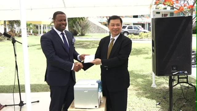 Resident Ambassador of the Republic of China (Taiwan), His Excellency Chiou Gow-Wei presents information systems to Deputy Premier and Minister of Health in the Nevis Island Administration Hon. Mark Brantley at the grounds of the Alexandra Hospital on September 18, 2015