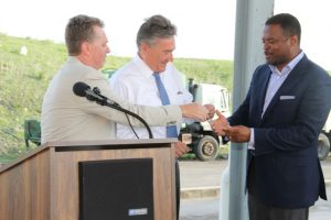 Deputy Premier and Minister of Health on Nevis Hon. Mark Brantley receives keys to two state-of-the-art Kenworth garbage collection trucks from Omni Global's Caribbean Region Operation Manager Steve Hammond, Omni Global Representative Davis Johnson at a handing over ceremony at the Long Point landfill on September 17, 2015