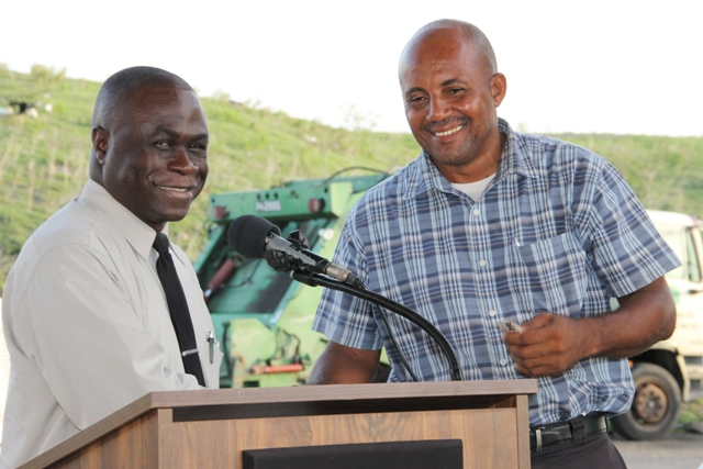 "General Manager of the Nevis Solid Waste Management Authority Andrew Hendrickson handing over keys to two state-of-the-art Kenworth garbage collection trucks to Operations Manager Dennis ""Rudy"" Browne at a handing over ceremony at the Long Point landfill on September 17, 2015"