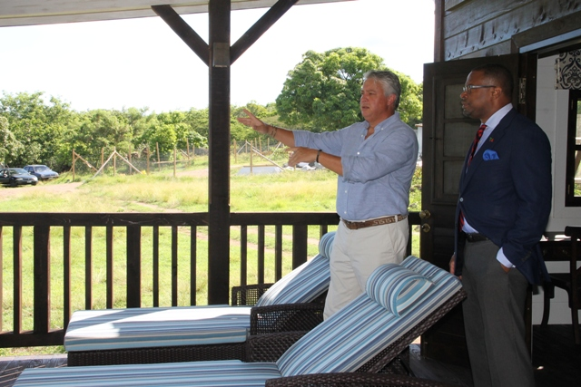 Deputy Premier and Minister of Tourism Hon. Mark Brantley tours the first completed unit at Paradise Palms with General Manager Jason Molle on September 23, 2015