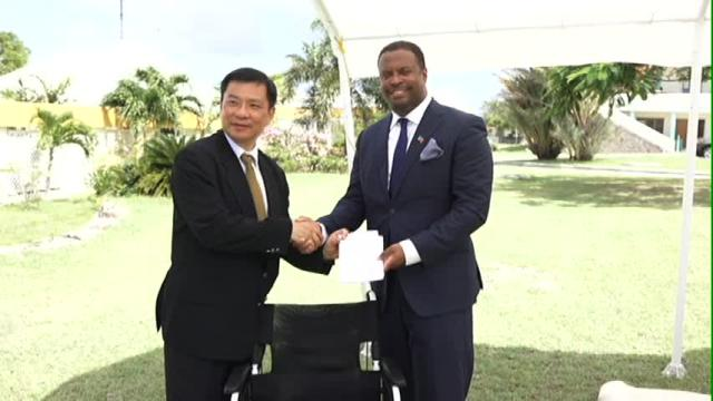 Resident Ambassador of the Republic of China/Taiwan, His Excellency Chiou Gow-Wei presents wheelchairs to Deputy Premier and Minister of Health in the Nevis Island Administration Hon. Mark Brantley at the grounds of the Alexandra Hospital on September 18, 2015