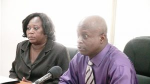 Permanent Secretary in the Premier's Ministry Wakely Daniel (r) and workshop facilitator Senior Officer at the Immigration Department in the Ministry of National Security Alicia Huggins at the start of a workshop for immigration officers at the Cotton Ground Police Station on October 21, 2015