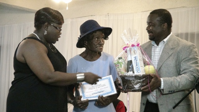 "Junior Minister of Social Development Hon. Hazel Brandy-Williams presents award to Florence ""Ella"" Merchant at the 3rd Annual Gala and Awards Ceremony hosted by the Department of Social Services Seniors Division at the Occasions Conference Centre on October 27, 2015"