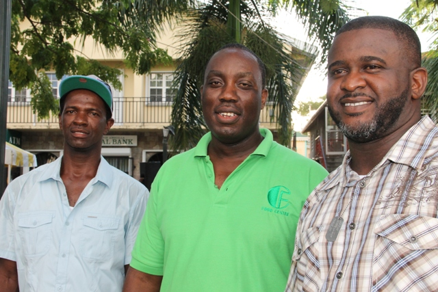 "Some executive members of the Nevis Bus Association (l-r) Vice President Davron Maynard, President Kurt Swanston and Public Relations Officer Charles ""Junie"" Liburd moments after the launch of the Ministry of Social Development's Seniors Subsidized Transportation Programme launched on October 01, 2015"