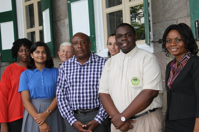 (Front row) Permanent Secretary in the Ministry of Tourism Carl Williams, flanked by (l) Nevis's reigning Junior Tourism Minister Tarana Kacker and (r) by Caribbean Tourism Minister Rol-J Williams and (extreme right) Tourism Education Officer in the Ministry of Tourism Vanessa Webbe. Back row (l-r) Product Development Officer in the Ministry of Tourism Nicole Liburd, Education and Tourism Representative Deborah Lellouch and Chaperon and Principal of the Nevis International Secondary School Joy Napier at Bath on October 16, 2015