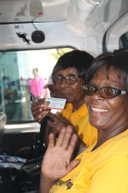 Visibly happy Seniors taking a short drive around the Memorial Square in Charlestown, moments after the Ministry of Social Development's Seniors Subsidized Transportation Programme was launched at the Memorial Square in Charlestown on October 01, 2015