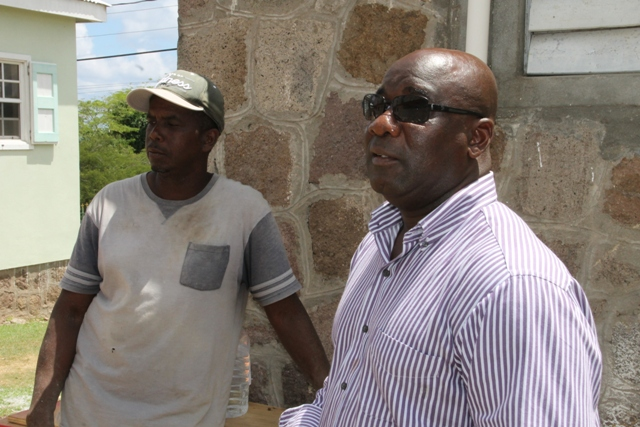 Minister of Housing and Lands on Nevis Hon. Alexis Jeffers and contractor for the Joycelyn Liburd Primary School expansion project Carlisle Maynard at the site of the project on September 28, 2015