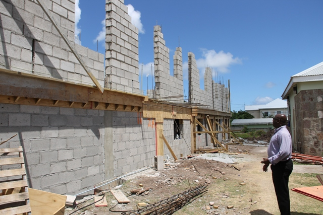 The back view of ongoing construction work for the expansion of the Joycelyn Liburd Primary School showing storage areas