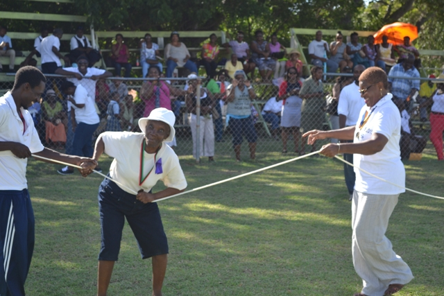Lisa Jeffers, 95, dancing with Meredith Amory-Field under the watchful eye of an official from the Department of Sports at the first ever Seniors Fun and Action Games hosted by the Ministry of Social Development, Senior's Division at the Elquemedo Willet Park on October 15, 2015