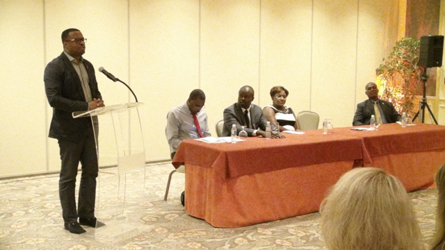 Deputy Premier of Nevis and Minister of Tourism Hon. Mark Brantley delivering remarks at the inaugural Nevis Travel Symposium of Romance for travel professionals at the Four Seasons Resort on October 19, 2015, hosted by the Nevis Tourism Authority. Sitting at the head table are (l-r) Director of Sales and Marketing at the Nevis Tourism Authority and Chairman for the ceremony Devon Liburd, Chief Executive Officer of the Nevis Tourism Authority Greg Phillip, Chief Executive Officer of Dreamy Weddings Nathalie John and Premier of Nevis Hon. Vance Amory
