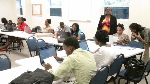 Some of the participants at a two-week Quick Books Accounting training session for small business owners with facilitator Alexa Pemberton (standing), hosted by the Ministry of Finance in conjunction with the Small Enterprise Development Unit at the Nevis Department Disaster Management conference room at Long Point on October 23, 2015