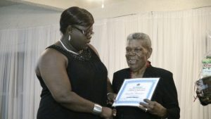 Junior Minister of Social Development Hon. Hazel Brandy-Williams presents award to Pauline Brister at the 3rd Annual Gala and Awards Ceremony hosted by the Department of Social Services' Seniors Division at the Occasions Conference Centre on October 27, 2015