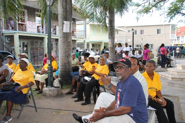 A section of persons who attended the launch of the Ministry of Social Development's Seniors Subsidized Transportation Programme at the Memorial Square in Charlestown on October 01, 2015