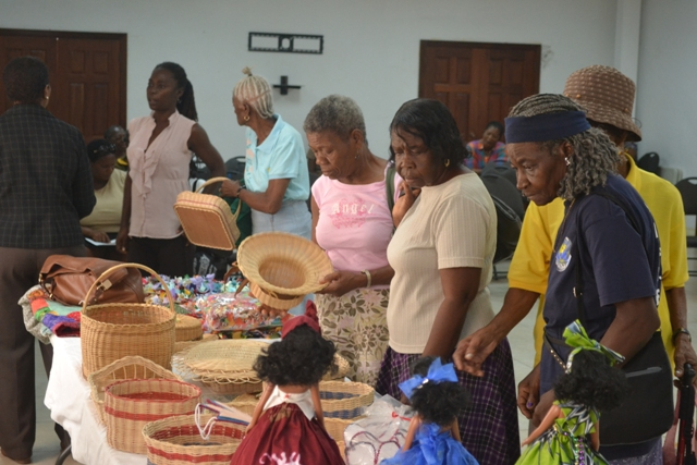 Seniors examining craft work done by their colleagues at a mini exhibition at St. Paul's Conference Hall on October 12, 2015