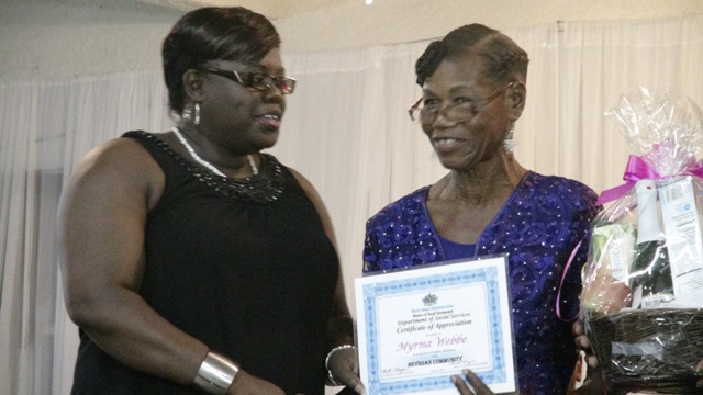 Junior Minister of Social Development Hon. Hazel Brandy-Williams presents award to Myrna Webbe at the 3rd Annual Gala and Awards Ceremony hosted by the Department of Social Services Seniors Division at the Occasions Conference Centre on October 27, 2015