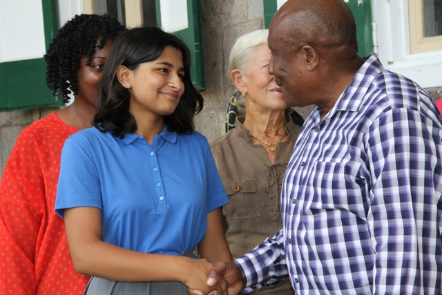 Permanent Secretary in the Ministry of Tourism Carl Williams at Bath on October 16, 2015, wishing Nevis's reigning Junior Tourism Minister Tarana Kacker well in her endeavours at the upcoming Caribbean Tourism Organisation's Tourism Youth Congress in Curacao