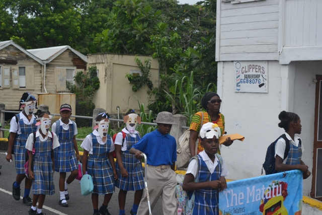 Students from the St. James' Primary School among the students marching through Charlestown at the start of the first Rainforest of Reading Book Festival on November 06, 2015