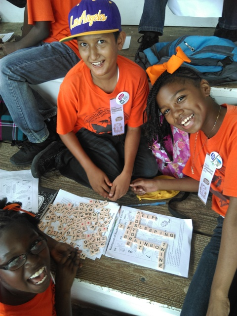 Students from the Charlestown Primary School at the Elquemedo T. Willett Park at the first Rainforest of Reading Book Festival in Nevis on November 06, 2015
